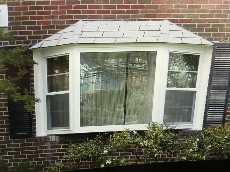 After-New bay window replacing double hung and picture window