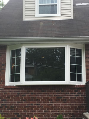 After-Double hung / picture window replaced by beautiful bay window with casements
