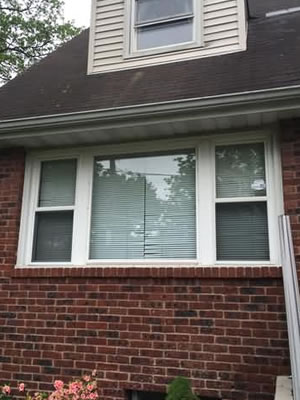 Before-Double hung / picture window replaced by beautiful bay window with casements