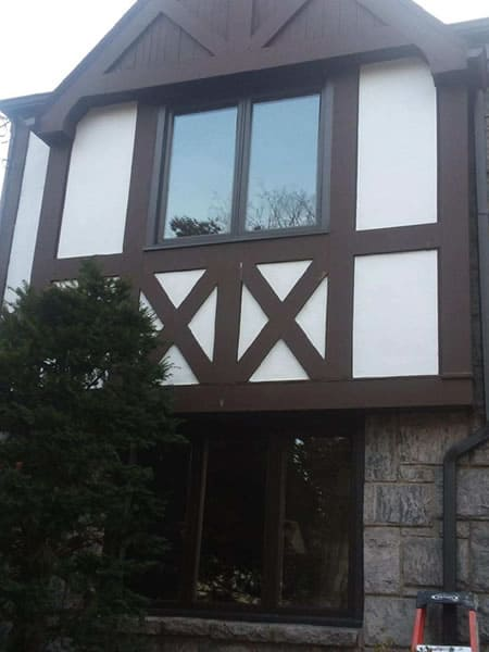 After-First and second floor crank windows replaced with energy efficient casement windows